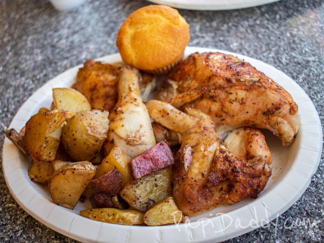 Knott's Berry Farm rotisserie chicken with roasted potatoes from Boardwalk BBQ.